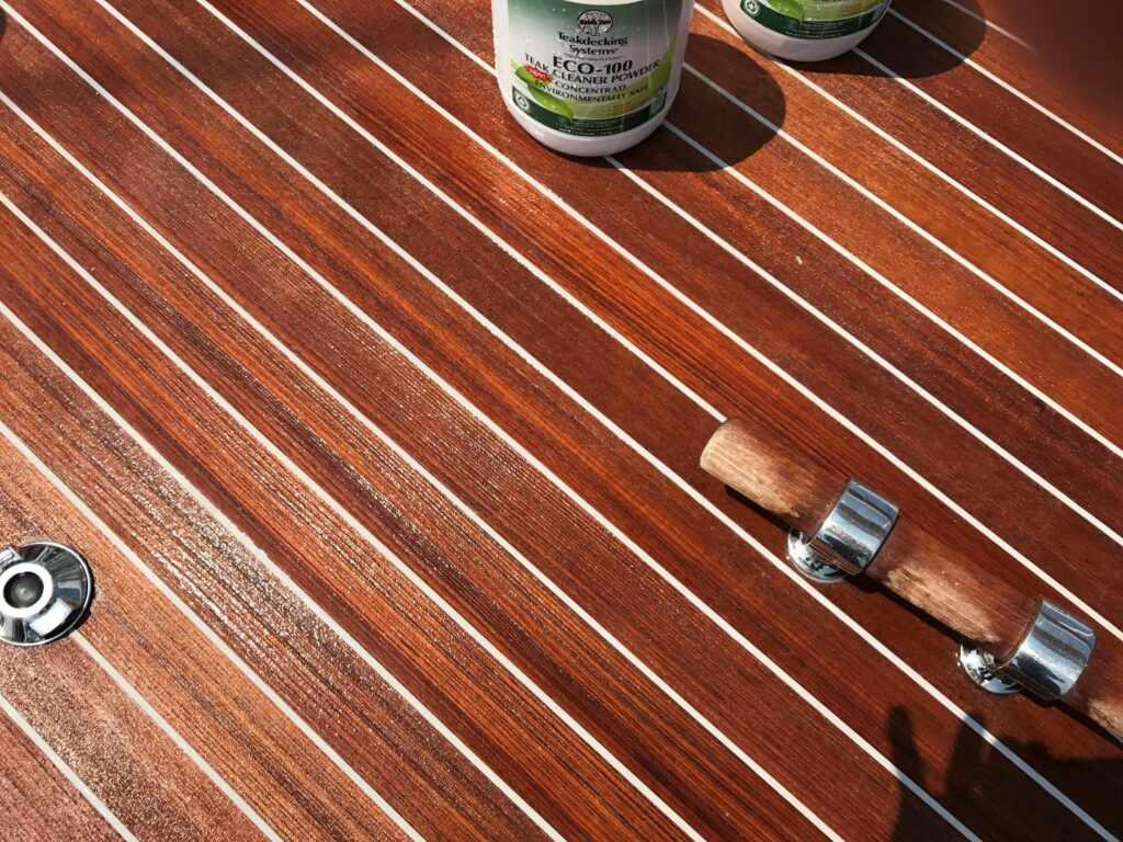 Clean deck with white seams and partial image of ECO-100 cleaner