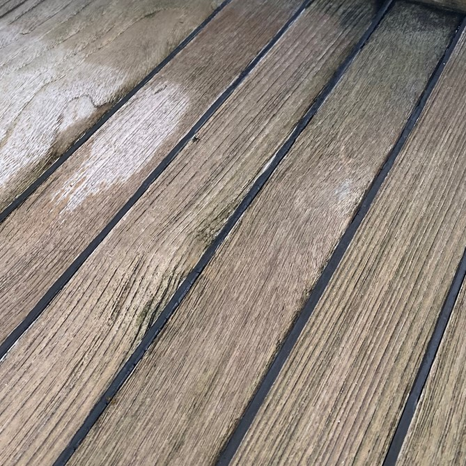 image of teak deck with deep ridges in the wood
